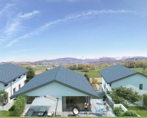 Vue sur 3 maisons avec grandes terrasse dont une est occupée par une famille, salon extérieur à l'avant plan et paysage de montagnes en arrière plan
