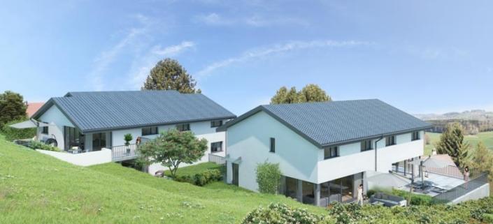 Vue sur deux villas avec verdure et terrasse, deux parasols ouverts et une dame sur les deux terasses côté droit de l'image