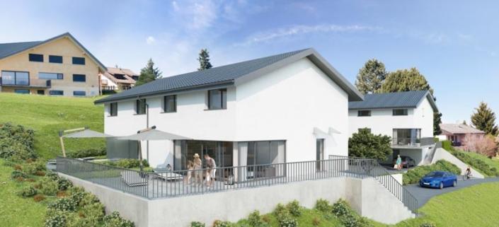 Vue sur deux maisons blanche au toit gris avec grande terrasse sur laquelle se trouve une famille, entourées de verdure et voiture sur le côté droit