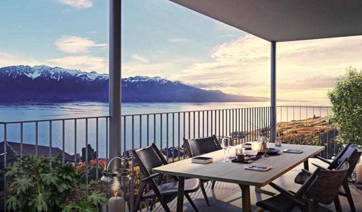 vue panoramique sur le lac léman et les montagnes depuis une terasse sur laquelle se trouve une table et des chaises